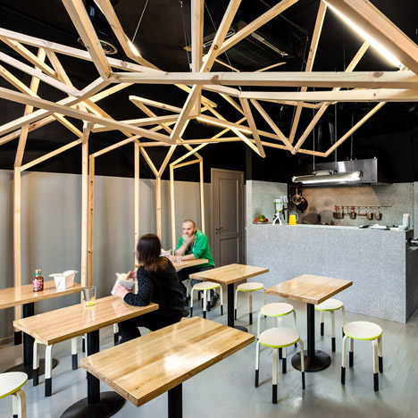 Thai noodle bar with a forest-like wooden canopy by Moko Architects