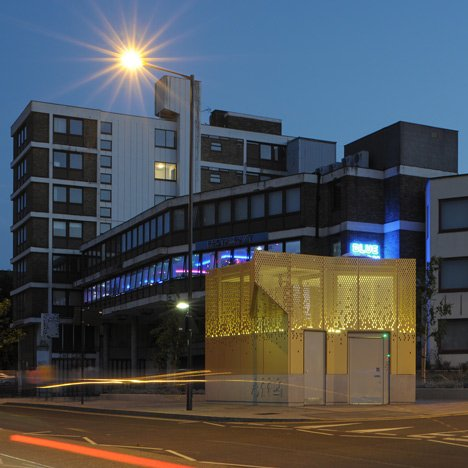 "Golden public toilet by Gort Scott aims to ""inspire confidence"""