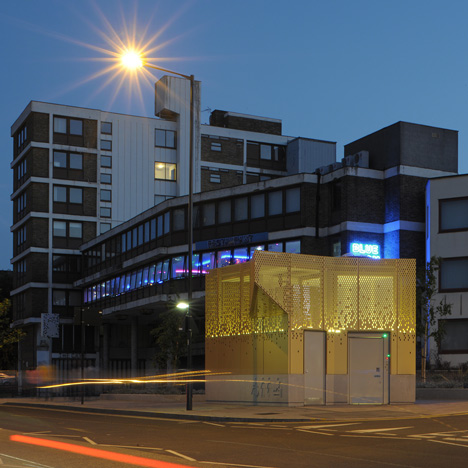 Golden public toilet by Gort Scott  aims to