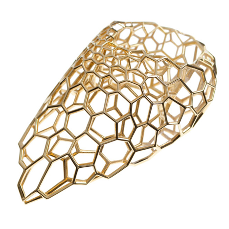Zaha Hadid creates latticed gold<br /> jewellery for Caspita