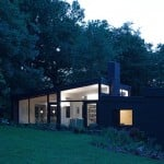 Black brick house in the woods by Takero Shimazaki and Charlie Luxton