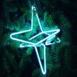 Glowing stars by Pernilla Ohrstedt decorate Christmas tree in London hotel
