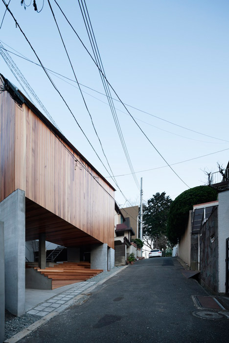 House by Kazuhiko Kishimoto with a public seating deck and gallery underneath
