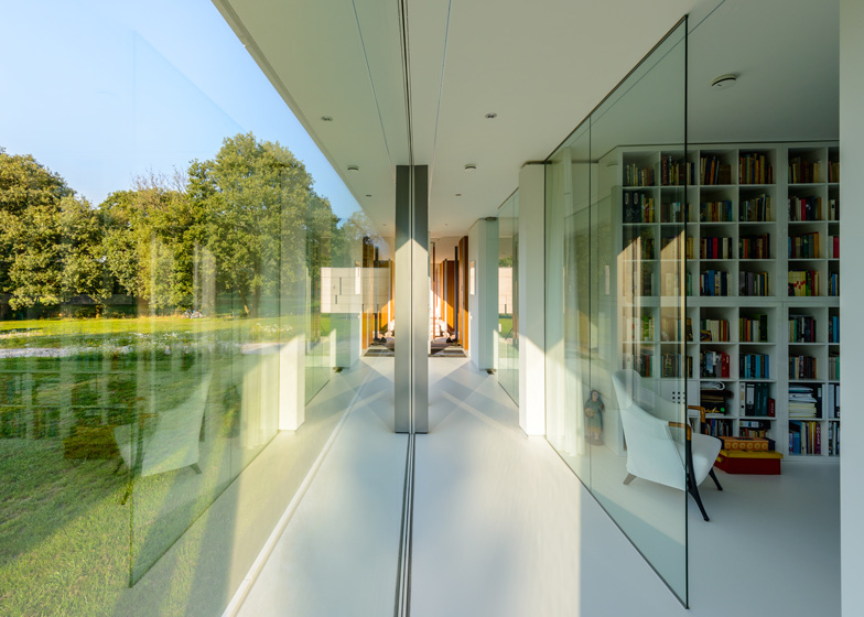 Dutch studio Inbo hides a transparent house behind a grove of trees