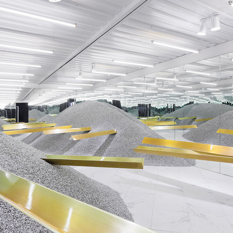 Golden girders protrude from piles of gravel to display sunglasses