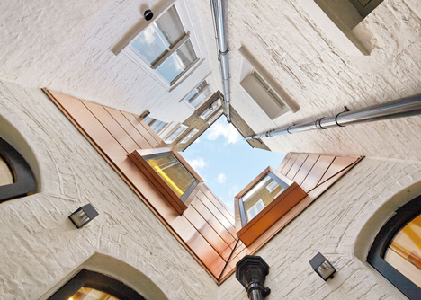 Great James Street Office extension with a faceted copper roof by Emrys Architects