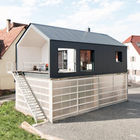 House Unimog that stores a truck within its translucent base by Fabian Evers Architecture and Wezel Architektur
