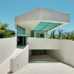 Wiel Arets' Jellyfish House features an elevated swimming pool with a glazed underside