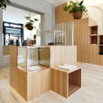 Kloke shop interior features copper clothes rails and wooden display units by Sibling
