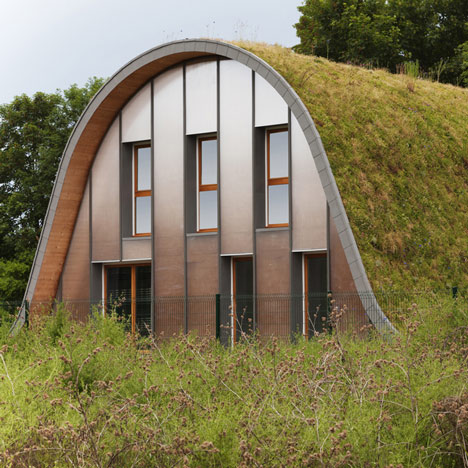 Hump-shaped house covered in plants by Patrick Nadeau