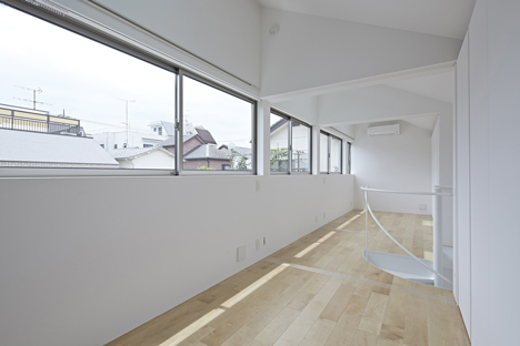Long Window House by Another Apartment has no windows on its front