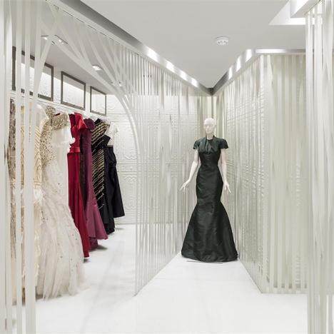 Belgravia boutique reveals evening gowns through bespoke metal screens