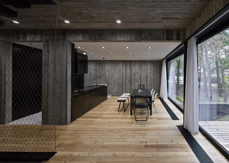 Polish House With Wood Textured Concrete Interior