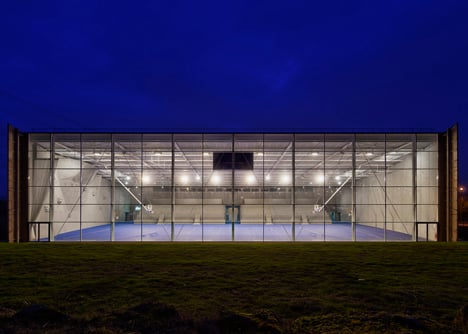 Sports centre clad with sun-bleached wooden slats by Explorations Architecture