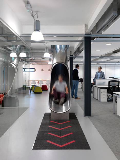The Workshop offices with a slide through the centre by Guy Holloway