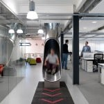 The Workshop offices by Guy Hollaway Architects feature a tubular steel slide