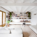 Traditional floor tiles arranged in stripes in a Barcelona apartment by Bach Arquitectes