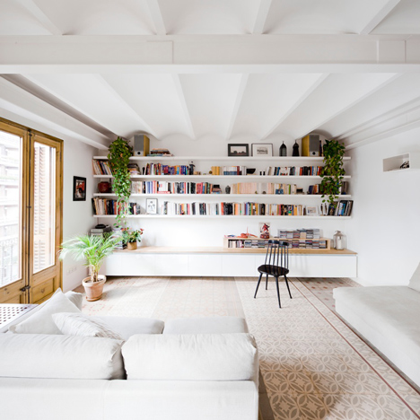 Traditional floor tiles arranged in stripes in a<br /> Barcelona apartment by Bach Arquitectes