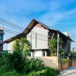 Seven-metre doors reveal a courtyard inside TACHA_Design's Baan Yo Yen house