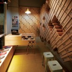 Footwear store interior covered with stacked shoe boxes by Move Architects