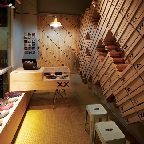 Footwear store interior covered with shoe boxes by move for Design in a box interior design