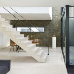 Blackbox mews house by Form_art Architects has brick walls inside and out