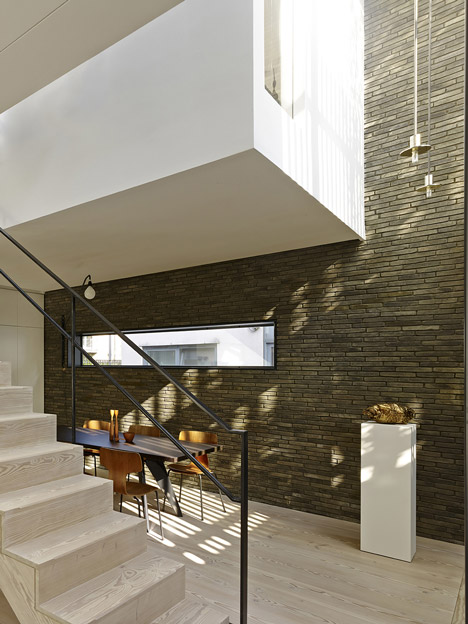 Blackbox mews house by Form_art Architects has brick walls that continue inside