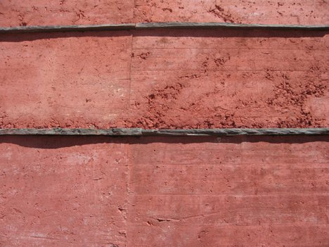 Red concrete visitor centre by Gonçalo Byrne tells the story of the Battle of Atoleiros
