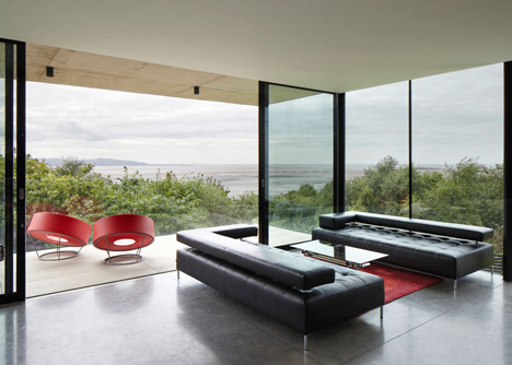 Coastal concrete house on a red sandstone base by ShedKM