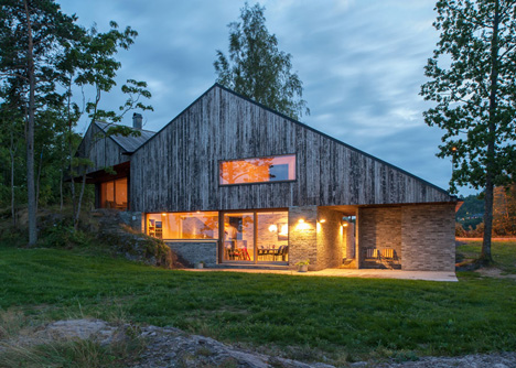 Double-gabled house overlooking a Norwegian fjord by Schjelderup Trondahl Architects