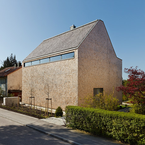Stuttgart house by (se)arch with shingle-clad<br /> walls and a triple-height art gallery