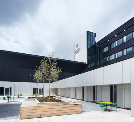 Manchester Metropolitan University art school extension with wooden stairs and bridges by Feilden Clegg Bradley Studios