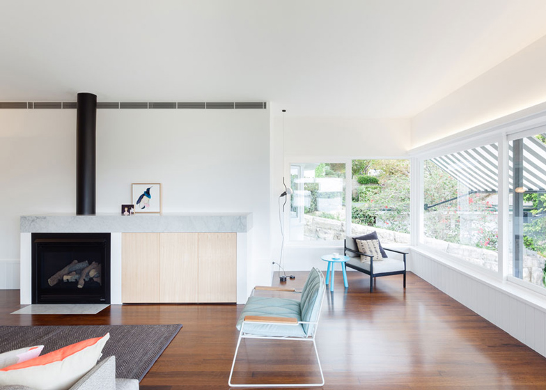 Renovated single-storey house with distorted ceiling voids by Tribe Studio