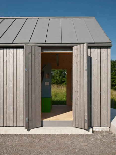Small museum pavilion designed to resemble a rural shed by Von M