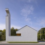 Church congregation hall by SAGRA Architects features a towering white belfry