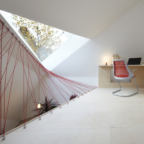 Parachute cables form netted balustrades at Fraher Architects' London studio