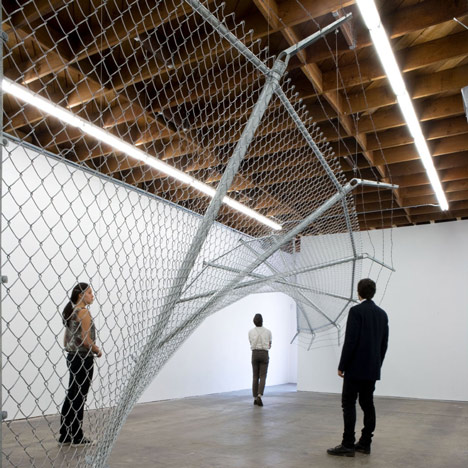 Twisting barbed wire fence installed by Didier Faustino at Cincinnati's Contemporary Arts Center