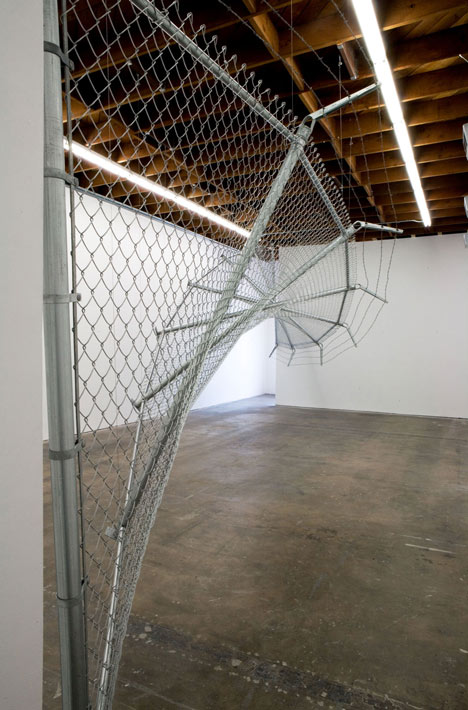 Twisting barbed wire fence installed by Didier Faustino at Cincinnatis Contemporary Arts Center