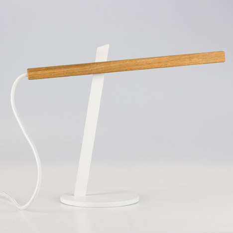 Two-piece magnetic Magnon desk lamp by Ilya Tkach