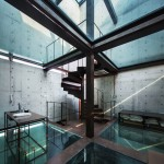 Vertical Glass House by Atelier FCJZ has glass floors instead of windows