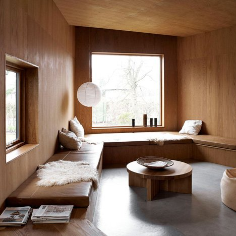 Family house by Wienberg Architects and Friis & Moltke contains cosy oak-lined rooms