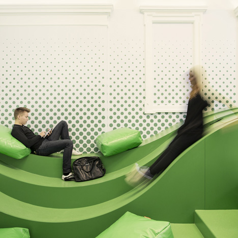 Wavy green lounge by Svet Vmes Architects replaces an old school entrance