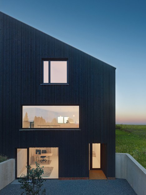 s_DenK house by SoHo Architektur has a kinked facade