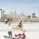 Timber-clad kindergarten by Behnisch Architekten opens in new housing district