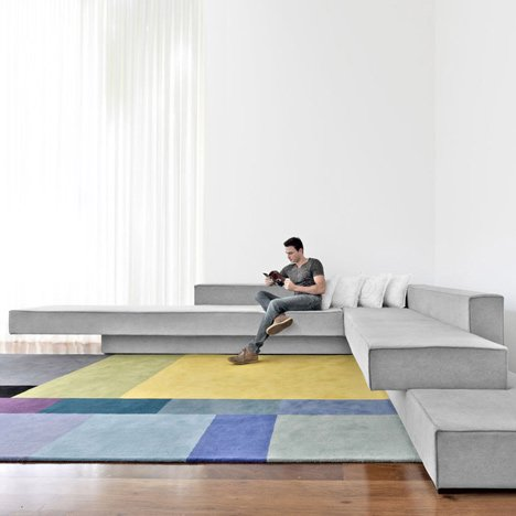 Cantilevered sofas by Paulo Kobylka fit together like stacked concrete slabs