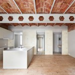 Vaulted brick ceilings revealed inside renovated Barcelona apartment