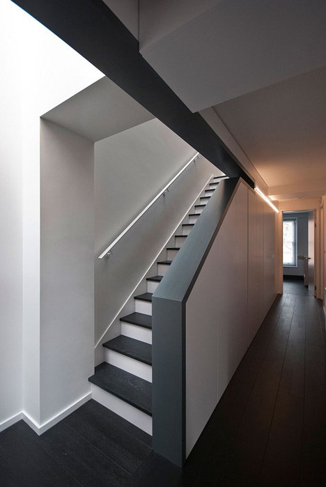 Long staircase spans converted London apartment by PATALAB Architecture