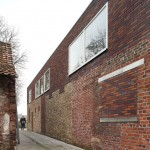 Community Centre Westvleteren by Atelier Tom Vanhee contrasts old and new bricks