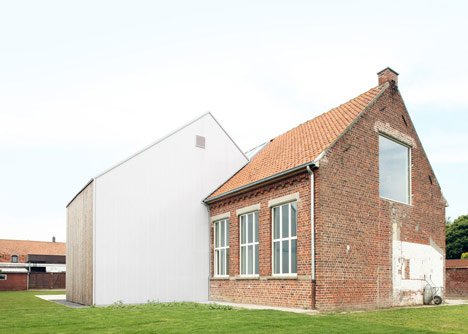 Community Centre Woesten by Atelier Tom Vanhee has a contrasting gabled extension