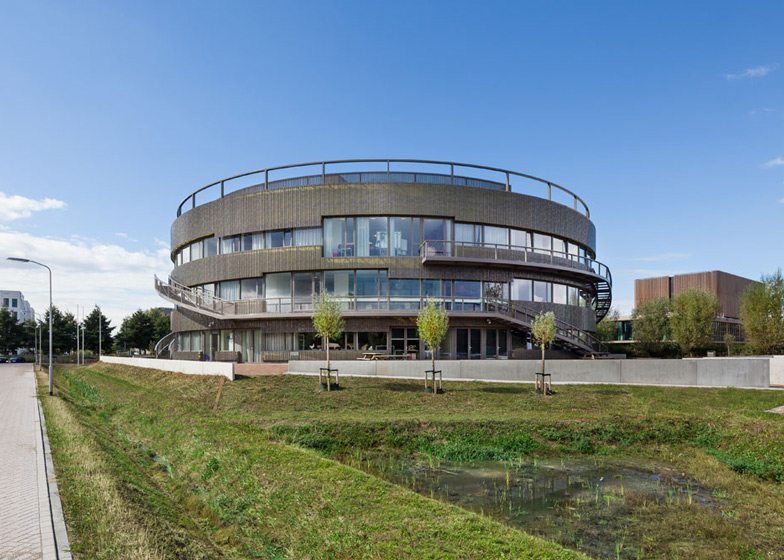 Ecological university building by BDG Architects features a cylindrical facade